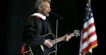 """Rock star and philanthropist Jon Bon Jovi performs a new song during graduation ceremonies at Rutgers University-Camden Thursday, May 21, 2015, in Camden, N.J. The New Jersey native premiered a new song, """"Reunion,"""" which he said was a gift to the graduates. It began, """"This isn't how the story ends, my friends, it's just a fork along the road."""" Bon Jovi and Bryan Stevenson, public interest lawyer and founder and executive director of the Equal Justice Initiative, received honorary degrees. (AP Photo/Mel Evans)"""